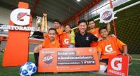 Somchai Ketchaikosol, centre, marketing director for Beverages of PepsiCo Services Asia Limited, poses with young football players at a media briefing recently.