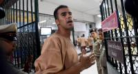 Hakeem al-Araibi, a Bahraini refugee and Australian resident, is escorted to a courtroom in Bangkok yesterday. // AFP PHOTO