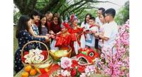 Children dressed up as God of Prosperity giving ang pow to two sets of test tube triplets in front of Suffolk House in Penang. They are (from left) Yin Han, Yin En, Yin Rou and their parents.