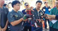 "Researchers from Chiang Mai University show off the prototype ""wildfire starting drone"", which is designed to start a controlled fire in inaccessible areas by dropping a chemical mixture in arid deciduous forests."