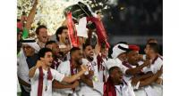 Qatar's players celebrate with the trophy after winning the 2019 AFC Asian Cup final. / AFP