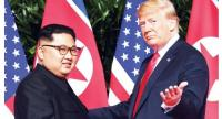 US President Donald Trump (right) meets North Korean leader Kim Jong-un at the start of their US-North Korea summit in Singapore on June 12.//AFP