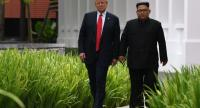 In this file photo taken on June 11, 2018 North Korea's leader Kim Jong Un (R) walks with US President Donald Trump (L) during a break in talks at their historic US-North Korea summit, at the Capella Hotel on Sentosa island in Singapore./AFP