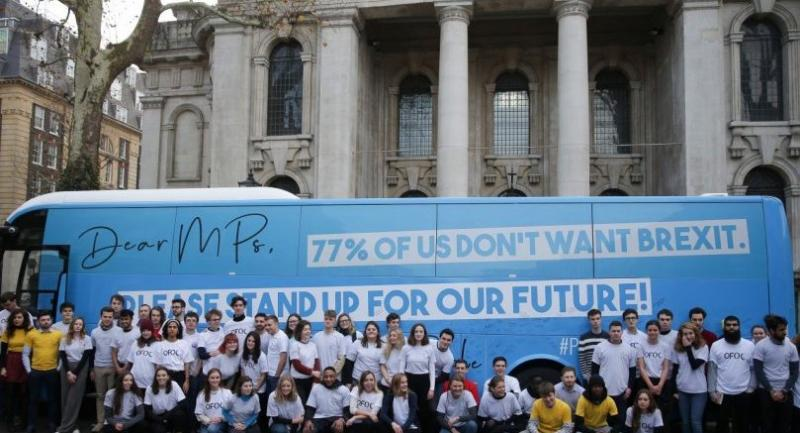 In this file photo taken on November 27, 2018 Members of Our Future, Our Choice (OFOC) a youth movement supporting a People's vote on the Brexit deal pose by a campaign bus in London./AFP