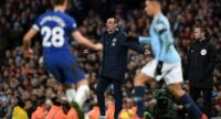 Chelsea's Italian head coach Maurizio Sarri shouts instructions to his players from the touchline. / AFP