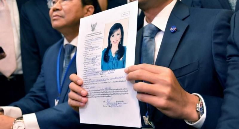 [FILE] Thai Raksa Chart Party leader Preechapol Pongpanich (R) shows a document nominating Princess Ubolratana Mahidol as candidate for prime minister during election registration at the Election Commission in Bangkok./EPA-EFE