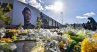 FC Nantes supporters gather in front of a portrait of late Argentinian forward Emiliano Sala prior to the French L1 football match between FC Nantes and Nimes Olympique at the La Beaujoire stadium in Nantes, western France on February 10.//AFP