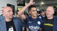 Refugee footballer Hakeem Al-Araibi (C) arrives at Melbourne International Airport in Melbourne, Australia, 12 February.//EPA-EFE