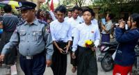 Myanmar students are escorted by police after a court hearing in Mandalay on February 13.//AFP