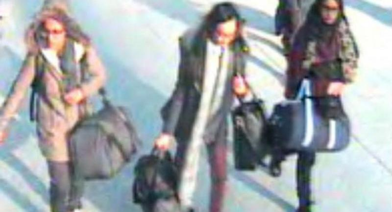 This file photo taken in 2015 shows (L-R) British teenagers Amira Abase, Kadiza Sultana and Shamima Begum at Gatwick Airport, south of London.//AFP