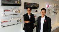 Nipon Wongsaengarunsri, right, Marketing Director, LG Electronics (Thailand) Co Ltd, and Varapong Oupakaew, Plant Director