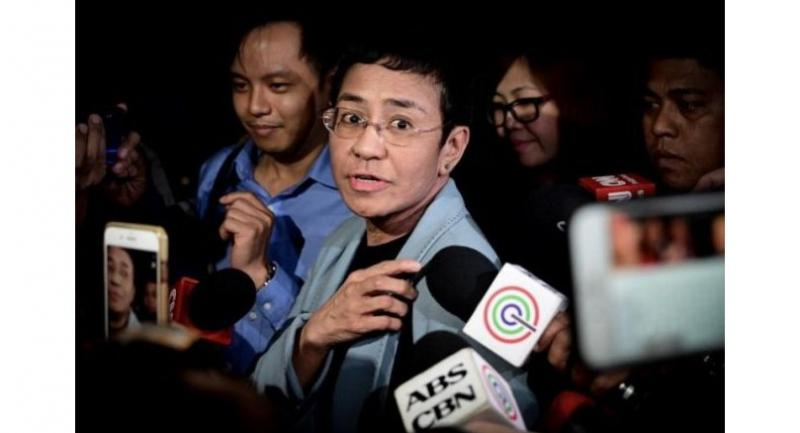 Maria Ressa speaking to media following her arrest inside the National Bureau of Investigation office in Manila on Feb 13.//EPA-EFE