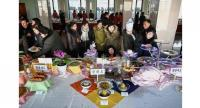Visitors looking at food made using potato flour displayed on a table during the North Korea's national cooking competition in Pyongyang. (Below) 'Naengmyeon', or cold potato noodles displayed during the cooking competition.//AFP