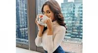 Miss Universe Catriona Gray sips coffee during her visit at the Miss Universe headquarters in New York City on Jan. 5, 2019. (Photo from her Facebook account)