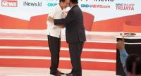 "Warm ending: Presidential candidate Joko ""Jokowi"" Widodo (left) embraces his contender, Prabowo Subianto, after the 2019 presidential candidate debate at Hotel Sultan in Jakarta on Sunday."