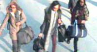 In this file handout photo taken on February 17, 2015 a video grab taken from CCTV shows shows (L-R) British teenagers Amira Abase, Kadiza Sultana and Shamima Begum at Gatwick Airport, South of London//AFP