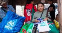 Ma Tway, a refugee from Ban Mae La camp, receives nonfood items before departing for Myanmar on Wednesday. ๊Photo CR: UNHCR/Chattriyaporn Singchum