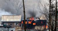A house in which militants are suspected to have sheltered is in flames after a gunfight happened between rebels and security forces that killed 4 soldiers, in South Kashmir's Pulwama on February 18.//AFP