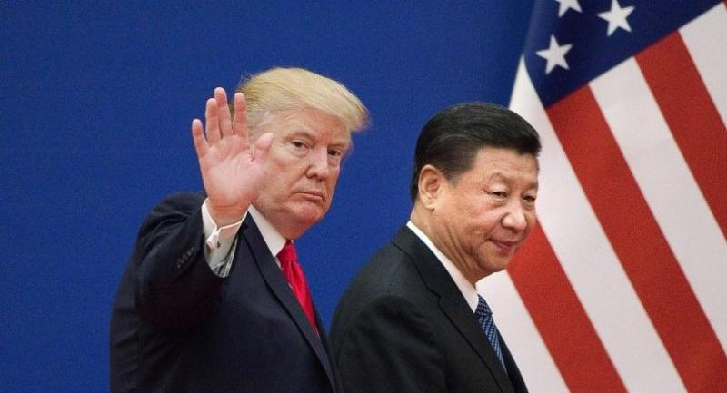 This file picture taken on November 9, 2017 shows US President Donald Trump (L) and China's President Xi Jinping leaving a business leaders event at the Great Hall of the People in Beijing./AFP