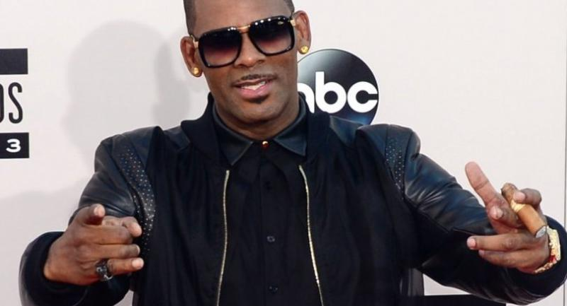 In this file photo taken on November 24, 2013, R Kelly arrives for the 2013 American Music Awards at the Nokia Theatre L.A. Live in downtown Los Angeles, California./AFP