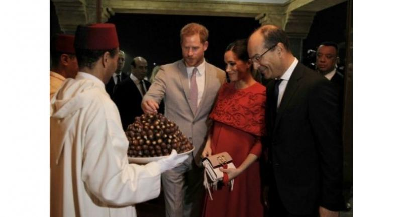 Prince Harry and Meghan were given a traditional welcome with a tray of dates on their arrival in Morocco. Photo/AFP