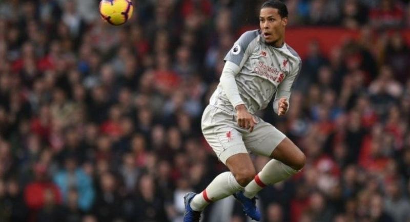 Liverpool's Dutch defender Virgil van Dijk heads the ball during the English Premier League football match between Manchester United and Liverpool.
