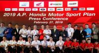 Suchart Arunseangroj, director of A.P.Honda Co.,Ltd., fifth from right back row, in a photo shooting with Honda Racing team.