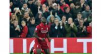 Liverpool's Senegalese striker Sadio Mane celebrates scoring during the English Premier League football match between Liverpool and Watford. / AFP