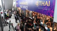 Stranded passengers wait the Thai Airways ticket counter at the Suvarnabhumi International Airport in Bangkok on February 28, 2019. // AFP PHOTO