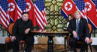 US President Donald Trump (R) and North Korea's leader Kim Jong Un hold a meeting during the second US-North Korea summit at the Sofitel Legend Metropole hotel in Hanoi on February 28.//AFP