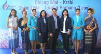 Bangkok Airways' Vice President-Sales Varong Israsena Na Ayudhya (4th from R) and Pakkanan Winijchai, director, Tourism Authority of Thailand (Chiang Mai Office), 3rd from R, jointly announce the launch of  the airline's new routes.