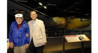 Retired Lt Col Dick Cole posed with Fumio Matsuo in front of the B-25 Mitchell Bomber at the National Museum of the Pacific War in Frederickberg , Texas on March 23, 2017.