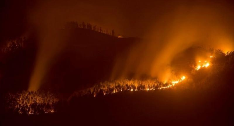 Flames rage through forest land near San Roman village in Cantabria, Spain, 04 March 2019. A total of 50 forest fires remain active in the region. // EPA-EFE PHOTO