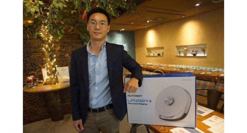 Thammasorn Meerat, co-founder and managing director of Robot Maker Co Ltd, presents Autobot robotic vacuum cleaner.