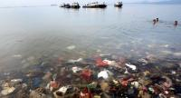 File photo: Plastic waste is seen submerged in water during an event to clear garbage from Lampung bay in the Sukaraja village in the Bumi Waras subdistrict of Bandar Lampung on February 21, 2019. // AFP PHOTO