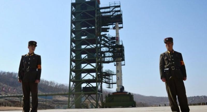 This file photo taken on April 8, 2012 shows two North Korean soldiers standing guard in front of the Unha-3 rocket at at the Sohae Satellite Launch Station in Tongchang-Ri.//AFP
