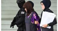 Doan Thi Huong (centre) is escorted by Malaysian police after a special court session to rule on witness statements at the Shah Alam High Court on December 14.//AFP
