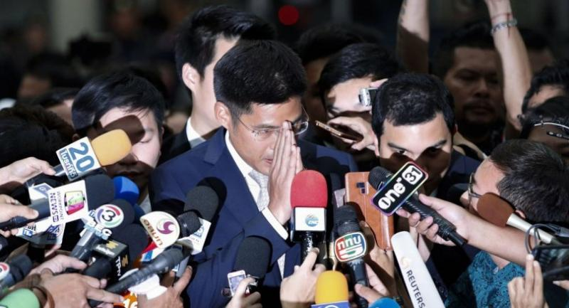 Thai Raksa Chart Party leader Preechapol Pongpanich (C) performs a traditional Thai greeting to journalists during an interview after the Constitutional Court ordered the dissolution of the party. // EPA-EFE PHOTO