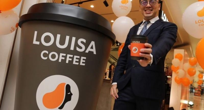 Chris Huang, founder and general manager of Louisa Coffee in Taiwan, expresses his confidence on the outlook for the cafe chain at a media briefing yesterday to announce the expansion into Thailand.