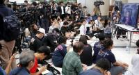 Journalist records a live TV broadcast of a judge delivering the decision of the Constitutional Court in Bangkok to dissolve the Thai Raksa Chart party yesterday.