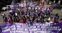 Filipino women holding a banner and placards march during a rally marking International Women's Day in Manila, Philippines, 08 March 2019.  // EPA-EFE PHOTO