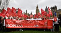 Workers from Japanese car maker Honda gather for a demonstration outside the Houses of Parliament in London on March 6, 2019 to urge the government to help persuade the company to reverse its decision to close its UK factory in Swindon./AFP