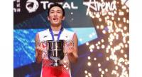Japan's Kento Momota poses with his trophy. / AFP