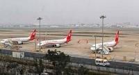 This photo taken on March 11, 2019 shows three Boeing 737 MAX 8 planes from Shanghai Airlines parked at Shanghai Hongqiao International Airport in Shanghai.//AFP