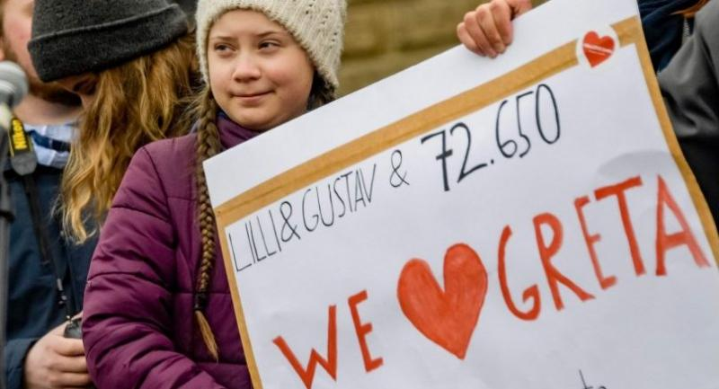 Swedish climate activist Greta Thunberg holds a placard bearing the number of signatures of a petition to support her during a demonstration of students calling for climate protection on March 1 in front of the cityhall in Hambourg, Germany.//AFP