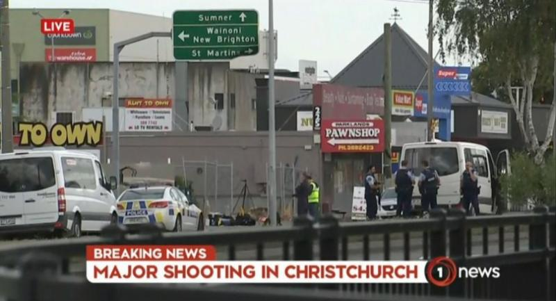 An image grab from TV New Zealand taken on March 15, 2019 shows New Zealand police officers cordoning the area near the mosque following a shooting in Christchurch.//AFP