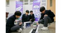 Students from Shinil Middle School uses Lego robot cars to learn about self-driving technology