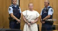 Brenton Tarrant, the man charged in relation to the Christchurch massacre, makes a sign to the camera during his appearance in the Christchurch District Court on March 16.//AFP