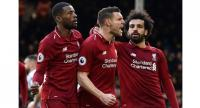 Liverpool's English midfielder James Milner (C) celebrates scoring the team's second goal.