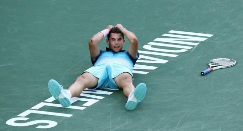 Dominic Thiem of Austria celebrates his men's singles final victory against Roger Federer . / AFP